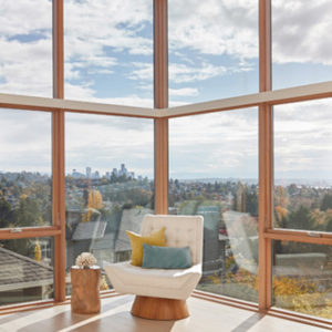 modern chair surrounded by windows with city view